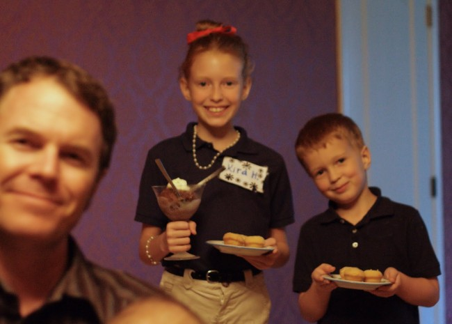 kids serving anniversary dinner